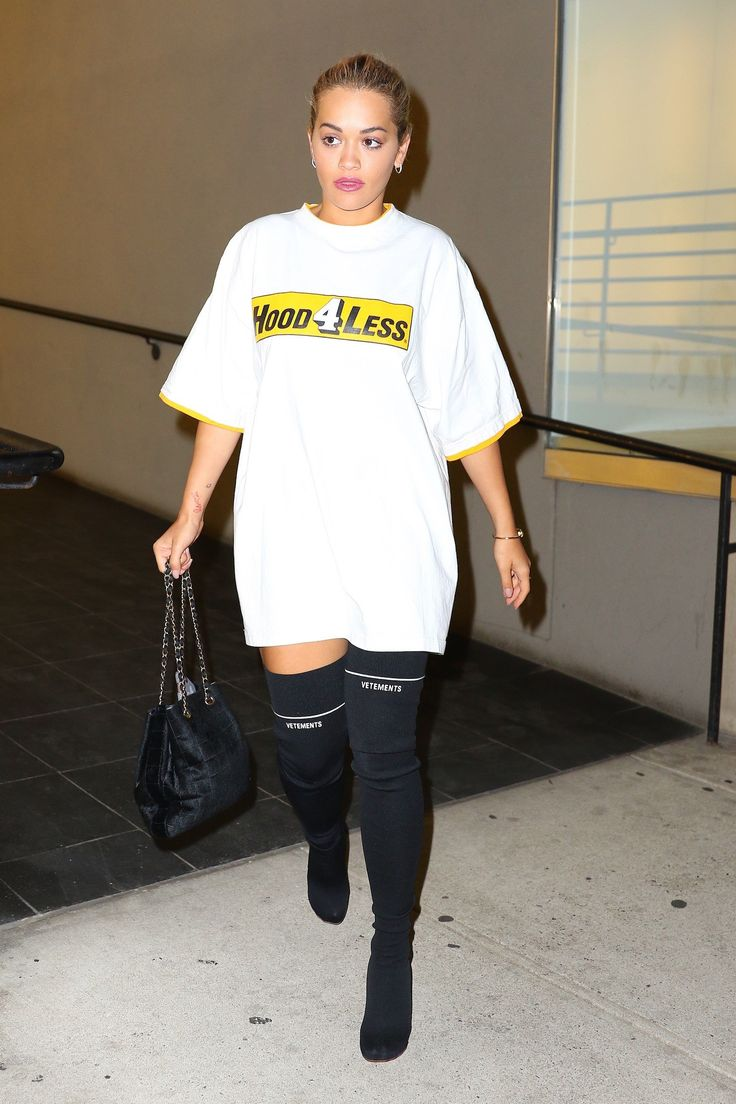 Rita Ora in Vetements sock jersey over-the-knee black boots and an oversize white T-shirt.