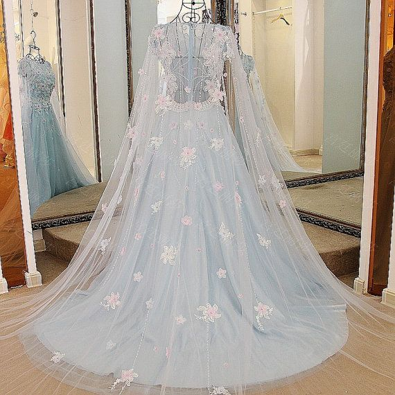 Item Type: Handmade Wedding Dresses Silhouette: A-Line Fabric:Tulle ; Lace;Linning Closure: zipper Decoration: Lace and appliques with crystal beadings Fully Lined: Yes Built-In Bra: Yes Boning: Yes Train: chapel train Size: Can Be Customized Tailoring Time: 2-3 weeks Shipping Time: 1-3 days  2, Color: Blue; or custom color 3, Size: standard size or custom size, if dress is custom made, we need to size as following bust______ cm/inch waist______cm/inch hip:_______cm/inch shoulder to shoulder…