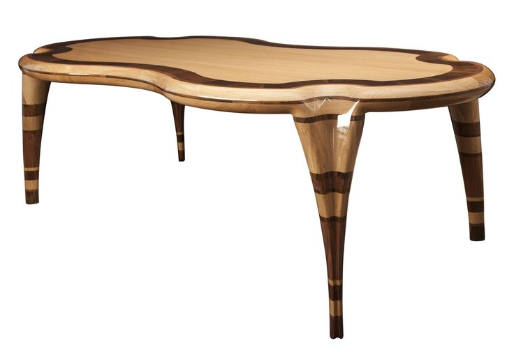 Hand-sculpted dining table of exquisite technique and quality. It is made by a combination of walnut, wenge and oak woods with a glossy veneer finish, inspired by the natural rocks of the Greek land.
