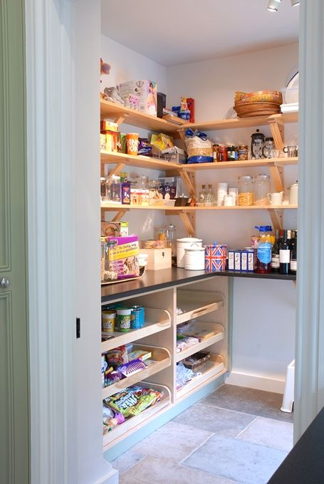 Bottom half with counter-top deep shelves, spot for the rolling pastry cart, top part in shelving, but with nice 'distressed' corbels as shelf supports.