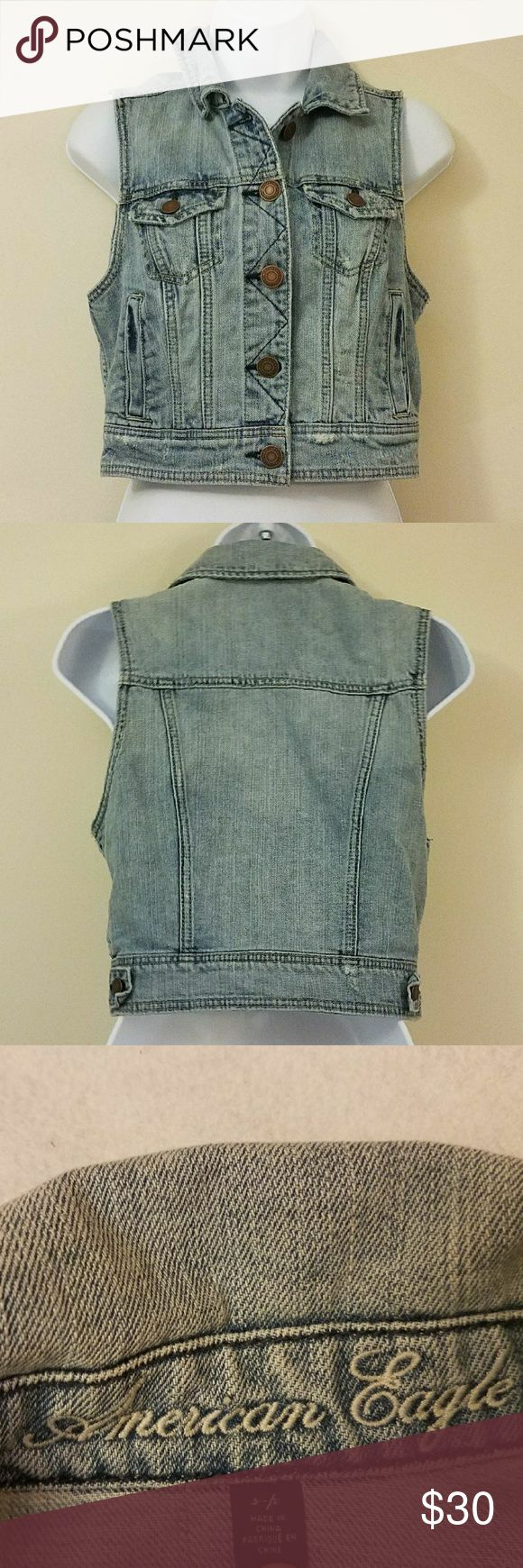 "American Eagle Distressed Vest Jacket American Eagle Distressed Light Wash Blue Jean Button Down Vest Jacket.? Size Small.? Gently used.? No flaws.? Please see photos for specifics.  Armpit to Armpit:? 16"" Length: 17""  Thank you for your business. American Eagle Outfitters Jackets & Coats Vests"