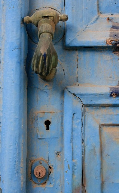 Door and knocker in Syros Island, Greece
