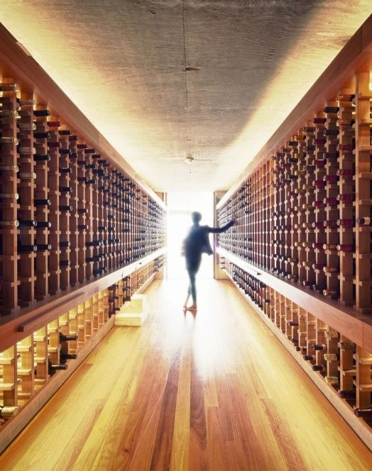 This person should start dancing like Michael J. I know I would in this wine lined corridor.