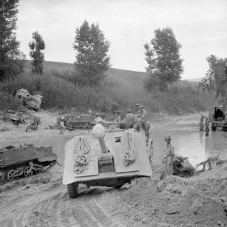 Anti-Tank Regiment is towed across the River Foglia during the assault on the Gothic Line