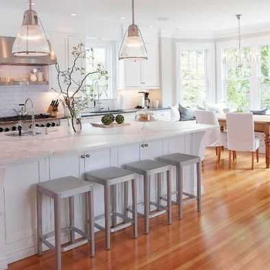 """Kitchen is approx. 16' x 26'; the window side of the bay is 8' and the banquette is 22"""" deep. Wall color is Benjamin Moore Edgecomb Gray; trim is bright white. Pendant lights are Hudson Valley (#7315) in satin nickel. Chandelier over table is Preciosa (model discontinued)."""