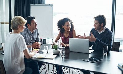 Shot of a group of coworkers in a boardroom meeting - stock photo #1320179