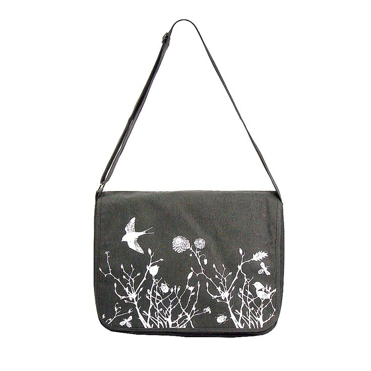 Canvas messenger bag with whimsical garden print.