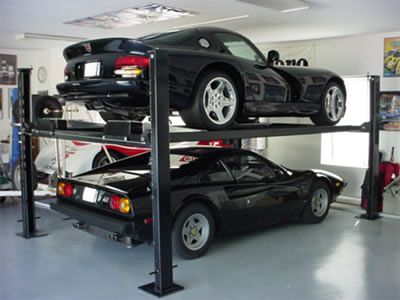 I've always wanted one of these car lifts for my garage!  (The cars in this photo are ok, too.)