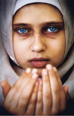 "Palestinian girl by Eman Mohammed. ""Defy(ing) social norms to become one of the only female photojournalists from Gaza."""