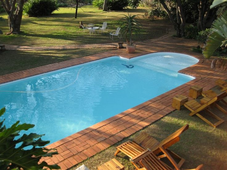 The pool is in a quite corner of the grounds, some of the accommodation over look it.