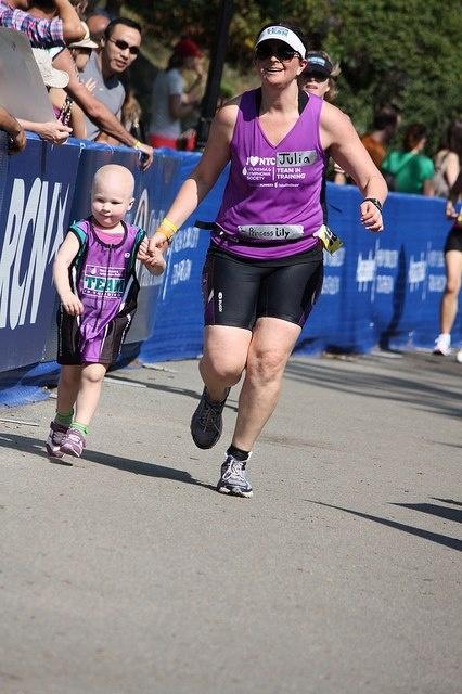 Julia Leavitt NYC Triathlon Finish with leukemia survivor Lilly