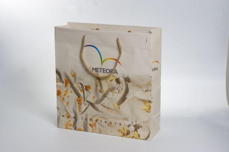 Shopping Bag, Corporate identity for the manufacturer of sofas: The Meteora. Art director: Mauro Giammarini Graphic Design: Mauro Giammarini Art work and Stiyling photo: Patrizia Laquale Photo: D.Barile Agenzia: MGAlterego