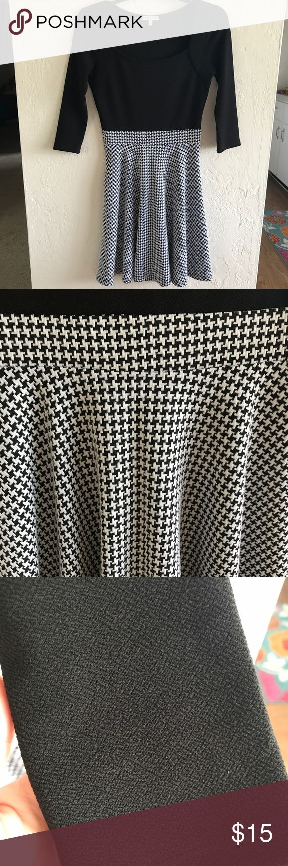 Black and White Skater Dress EUC skater dress. Worn once for a special occasion. Black on top with black and white design on bottom. 3/4 length sleeves. Cute! Charlotte Russe Dresses