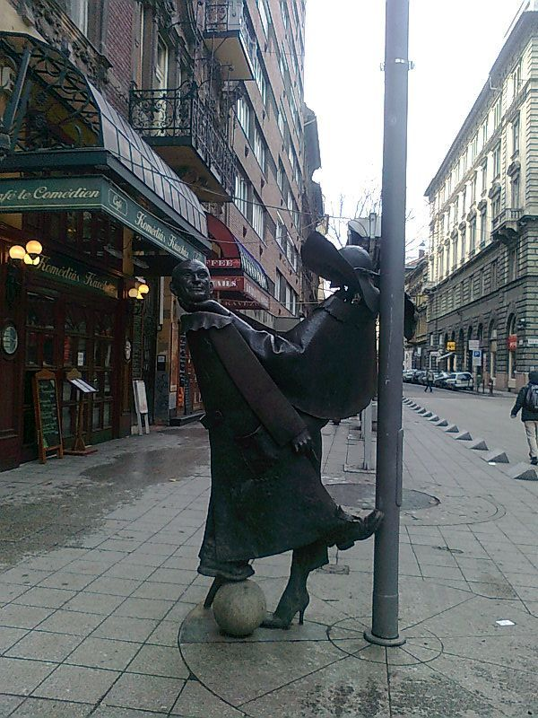 Geza Hofi, the great Hungarian humorist, parodist statue. Located in front of the Thalia Theatre on the Nagymező street. - Budapest, Hungary