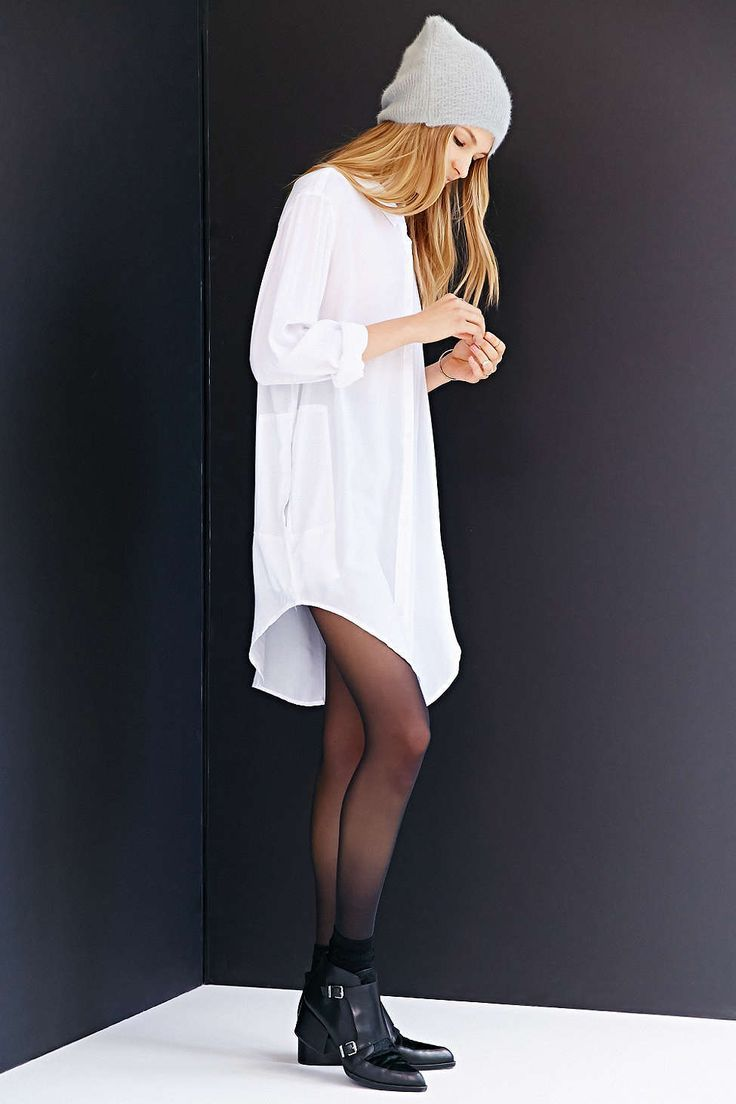Shop this look on Lookastic:  http://lookastic.com/women/looks/beanie-shirtdress-tights-socks-ankle-boots/10601  — Grey Beanie  — White Shirtdress  — Black Tights  — Black Socks  — Black Leather Ankle Boots
