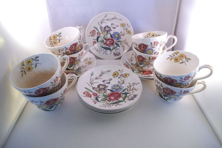 """Each saucer measures about 6"""" in diameter; each cup measures about 3 5/8"""" in diameter and 2 3/4"""" in height. One saucer has a small chip on the outer edge and a large spider crack on the bottom rim area.   eBay!"""