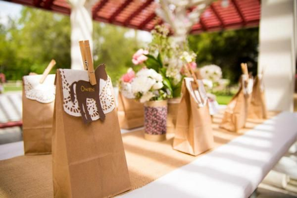 Pony Themed Birthday Party - Paper Lunch Bags with lace doilie and pony place card holders, very pioneer!