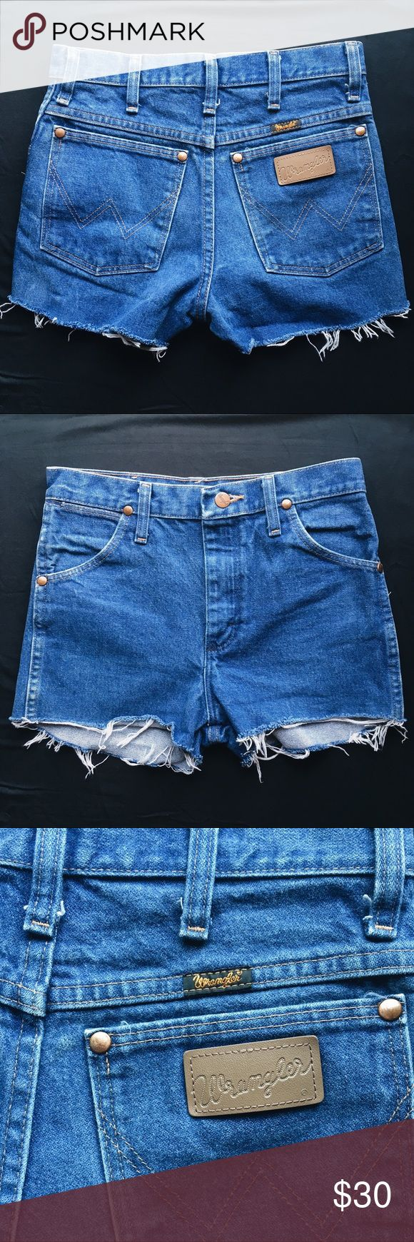 Vintage Wrangler high rise jean shorts 24 Super cute vintage denim shorts in a medium blue wash. Ordered online and they were way too small for me. I'm completely guessing on the true size here, so please measure yourself before buying. These are best for someone with very narrow hips. Rise: 10.5 in, Inseam: 2in, Waist: 26 in, Hips: 33 in Wrangler Shorts Jean Shorts