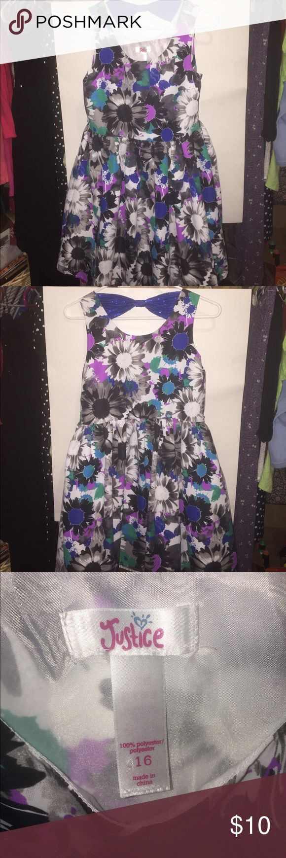 Justice Sleeveless Dress Size 16 Bold purple, blue, pink, black and white flowers perfect for a dance, church, or a sunny day. Knee length, with sequin bow behind the neck. Justice Dresses Casual