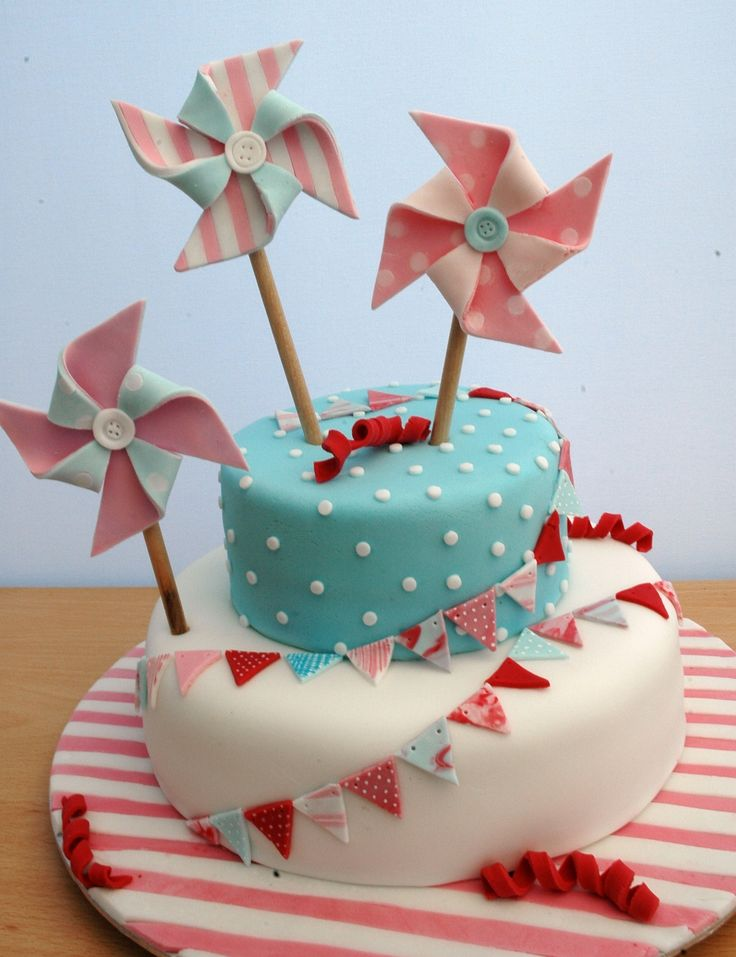 Candy Stripe Carnival - I wanted a more grown up yet girly cake for my 9 year old with a carnival/party theme. The dark colour looks red on the photos but was actually a deep pink. I loved doing the pinwheels - thanks to the people on CC that have posted bunting & pinwheel cakes for the inspiration