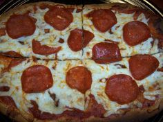Low Fat Pepperoni Pizza on a Flat Out from Food.com: Figure friendly pizza for under 250 calories! I like to serve this up with an Italian Salad.