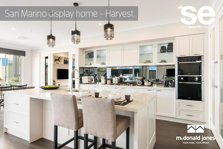 Love the pendant lights in this stunning Hamptons style kitchen! Do you like? #mcdonaldjones #hamptons #displayhome #kitchen #entertaining #pendantlights