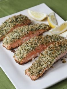 Barefoot Contessa - Recipes - Panko-Crusted Salmon: ²/³ cup panko (Japanese dried bread flakes)// 2 tablespoons minced fresh parsley// 1 teaspoon grated lemon zest// Kosher salt and freshly ground black pepper// 2 tablespoons good olive oil// 4 (6- to 8-ounce) salmon fillets, skin on// 2 tablespoons Dijon mustard// 2 tablespoons vegetable oil// Lemon wedges, for serving