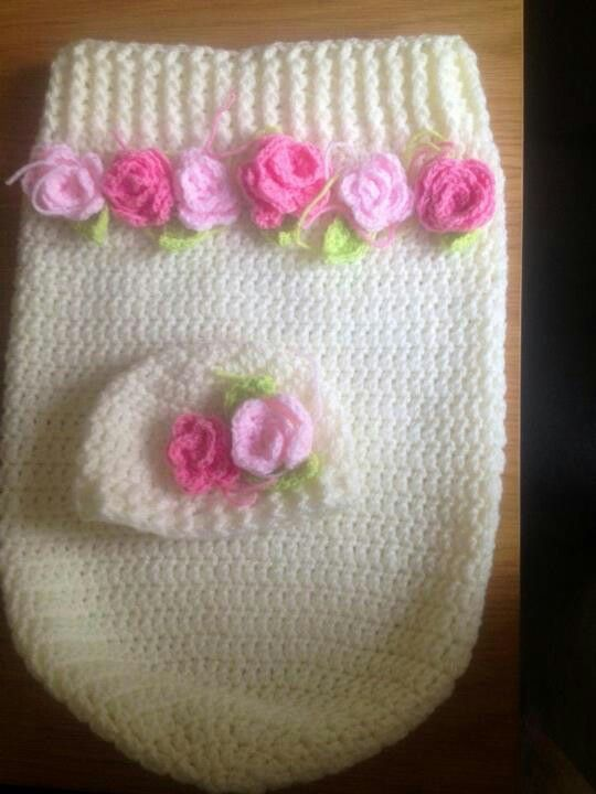 this is an adorable baby cocoon for that precious baby girl. unfortunately, there is no pattern, just this image that I repinned. BUT, you could find a basic pattern for the cocoon and then find some crocheted flower patterns to put on the swaddle.