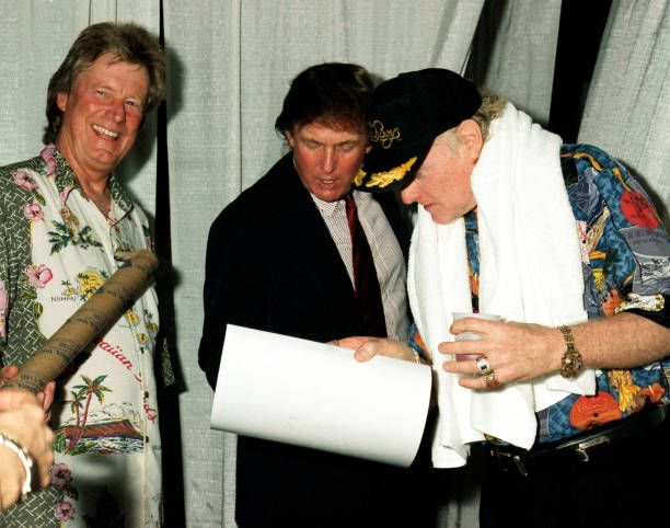 American musicians Dean Torrence from the group Jan and Dean and Mike Love from the Beach Boys speak with real estate developer Donald Trump at the...
