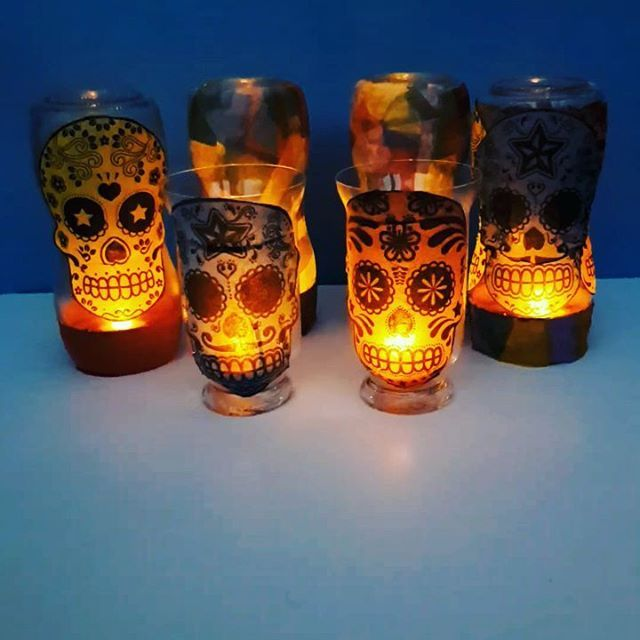 #bostikblogger October challenge.  I think these look rather spooky with their orange LED lights on!. Watered down Bostik glue, jars and Day of the Dead napkins.  Lovely messy play for an autumn day.  #Halloween #Halloweencraft #kidscraft #lanterns #dayof