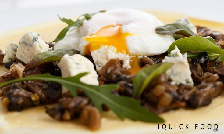 Balsamic caramelized mushroom crepes with blue cheese and a poached egg are everything you need for a delicious snack. Check it out y'all! #snack #mushroom #eggs #crepes