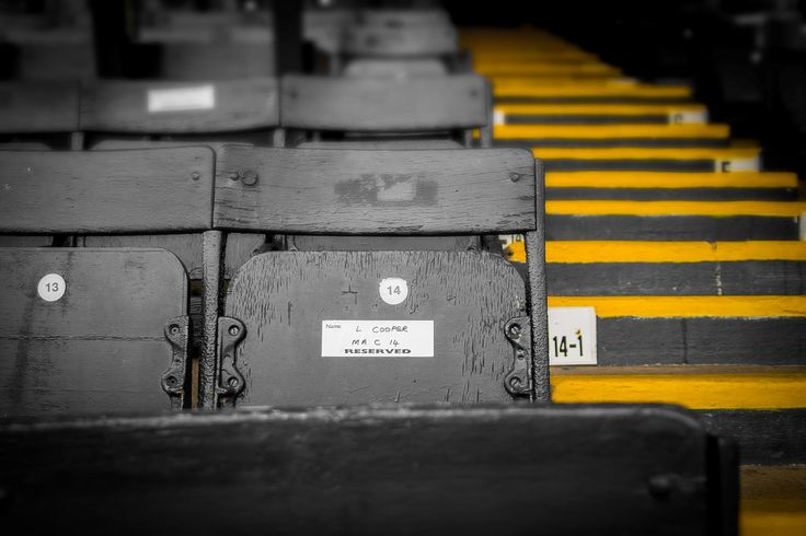 Old school wooden seating in the Main Stand at Starks Park in Kirkcaldy. The old…