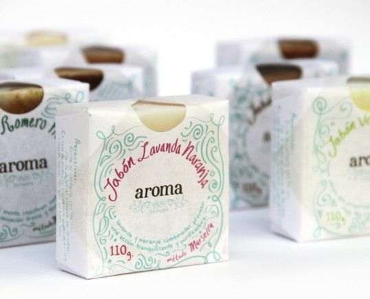 "Aroma by Claudio Limon: ""For this project the client asked me to create an affordable package where you could see, and smell the product. It also needed to be easy to package by hand and original... I... created a square, waxed paper wrapper. An oval die cut was added to allow the consumer to see and smell the product."" 