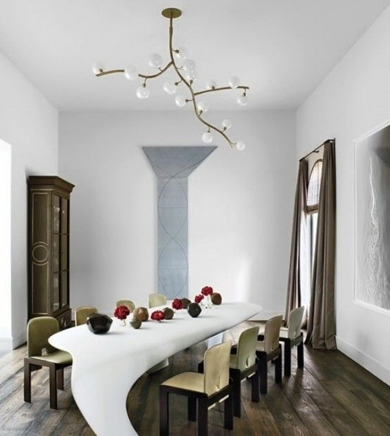 Fantastic dining table and modern chandelier.