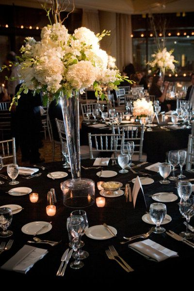 tall centerpiece sizing and blooms, slightly more greenery or green flowers for a more mixed green and white look