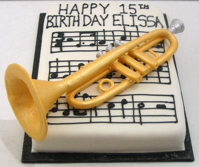 Happy Birthday to a trumpet player. Cake is vanilla and covered with buttercream and fondant. The cake is decorated with the music to Happy Birthday and the whole thing is topped with an edible t…