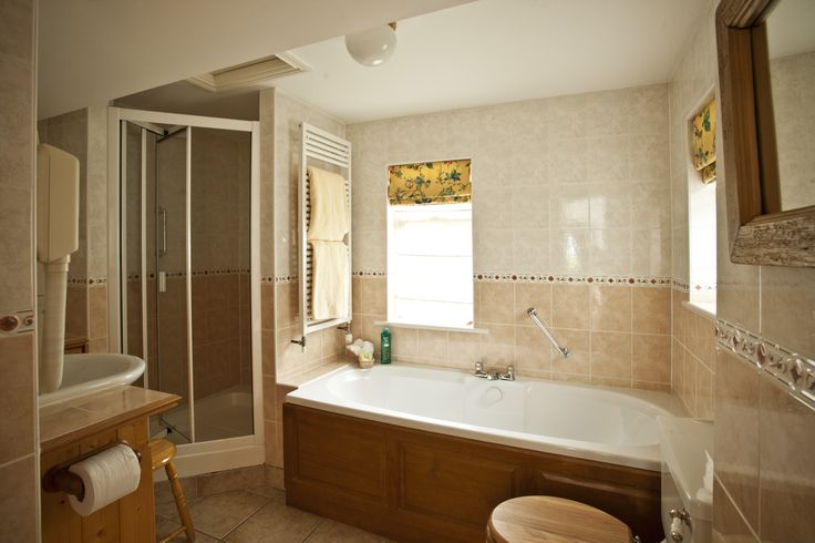 Luxury family bathroom with walk in power showers, separate double ended baths, under floor heating, heated towel rails & fitted hair dryers. Bathrobes, slippers and toiletries are also provided for your comfort and relaxation.