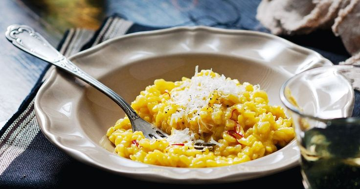 Creamy with butter and spiked with parmesan, this saffron-gilded risotto is a culinary classic.
