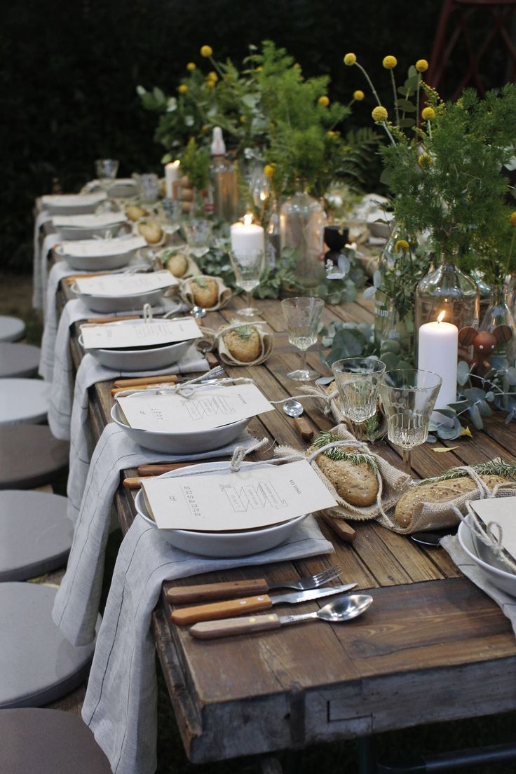 Wedding party table for a rustic wedding outdoor party, wooden table with green, silver and white details