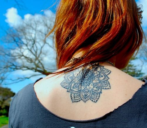 Mandala tattoo.  It is said that a mandala brings illumination, and also represents the feeling of rediscovering the sense and order.  <3