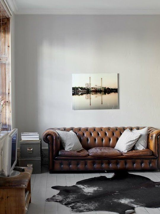 Chesterfield sofa, cowhide rug