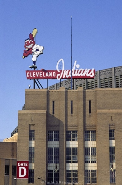 "chief wahoo atop gate D, outside the right field section; municipal stadium: cleveland, ohio (This is Municipal Stadium where both the Indians and the Browns formerly played. We used to go to ""Ladies' Days"" on Saturdays to watch the Indians for 35 cents! We'd take the bus from Berea and buy little oblong chocolate cakes at Kaase's bakery to eat on the way home; they were SO good! I also went to several Browns' games when I was older.)"