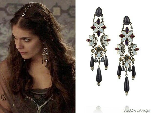 """In the episode 1x17 (""""Liege Lord"""") Lady Kenna wears these sold out Erickson Beamon 'Pretender' Gunmetal-Plated Swarovski Crystal Earrings. Worn with this BYIA dress, Colette Malouf headpiece, Stuart Weizman shoes."""