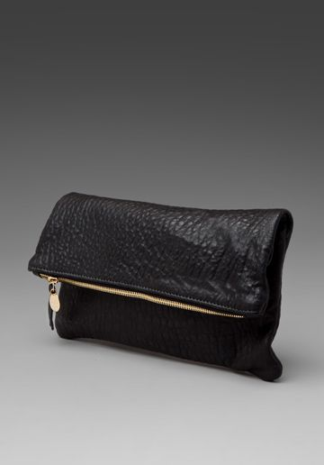 Clare Vivier clutch in pebbled black.  Love this!  Royal blue with red zipper is another option.