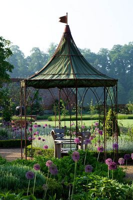 THE WALLED GARDEN AT COWDRAY, WEST SUSSEX. DESIGNER: JAN HOWARD - METAL GAZEBO WITH SEAT AND BOX EDGED BORDERS WITH ALLIUM 'PURPLE SENSATION'