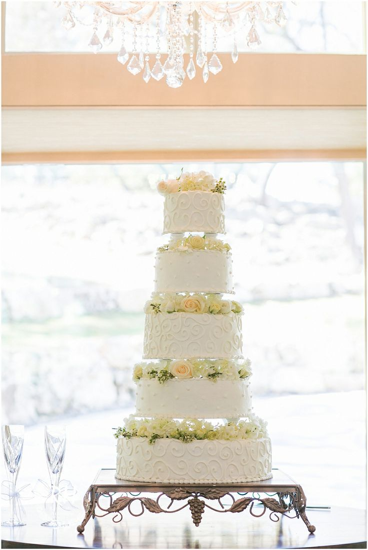 Elegant white wedding cake with fresh flowers. Lodge at Bridal Veil Falls, Spring Branch TX