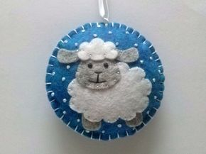 Felt Christmas Sheep ornament - White or Black Sheep, Blue or White background - wool blend felt / choice of color This listing is for 1 ornament Size about 8 cm Material wool blend felt Handmade from felt with high precision and great care. Please note that ornaments are decorated on one side only. Other side is solid blue or white. Santa ornament is a bit larger than sheep, reindeer, penguin and snowman ornaments For more Christmas ornaments visit my Christmas section https://www.etsy...