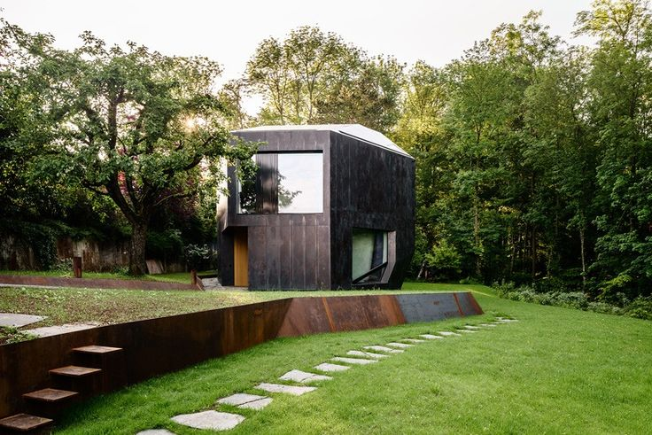 the southward-sloping plot is based not far from basel, with the earth-colored envelope featuring an angular character which engages in an ongoing dialogue with the natural environment.