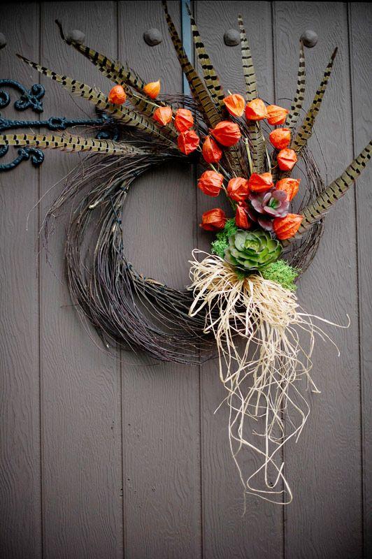 Pheasant Feather Twig Wreath   http://www.afloral.com/Wedding-Design-Ideas/Build-a-Centerpiece/Pheasant-Feather-Twig-Wreath