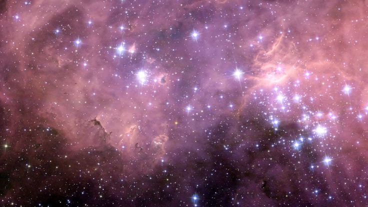 Hubble view of the huge star formation region N11 in the Large Magellanic Cloud. Credit: NASA, ESA and Jesús Maíz Apellániz (Instituto de Astrofísica de Andalucía, Spain). One of the most active star forming regions in our nearby Universe: N11 – also known as the Bean Nebula — a beautiful region of energetic star formation. The billowing pink clouds that look like cotton candy and bright bubbles of glowing gasses and are telltale signs that stars are being created.